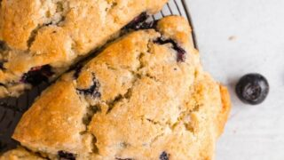 gluten free blueberry scones on a round wire cooling rack