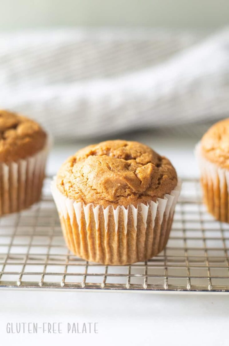 gluten free pumpkin muffin on a wire cooling rack