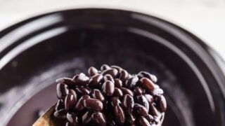 a wooden spoon ful of crockpot black beans