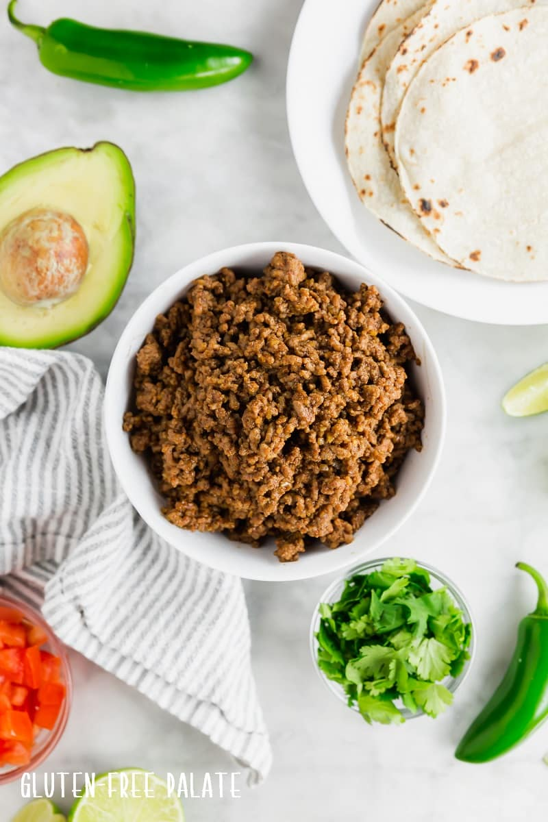 top down view of gluten free taco meat in a white bowl