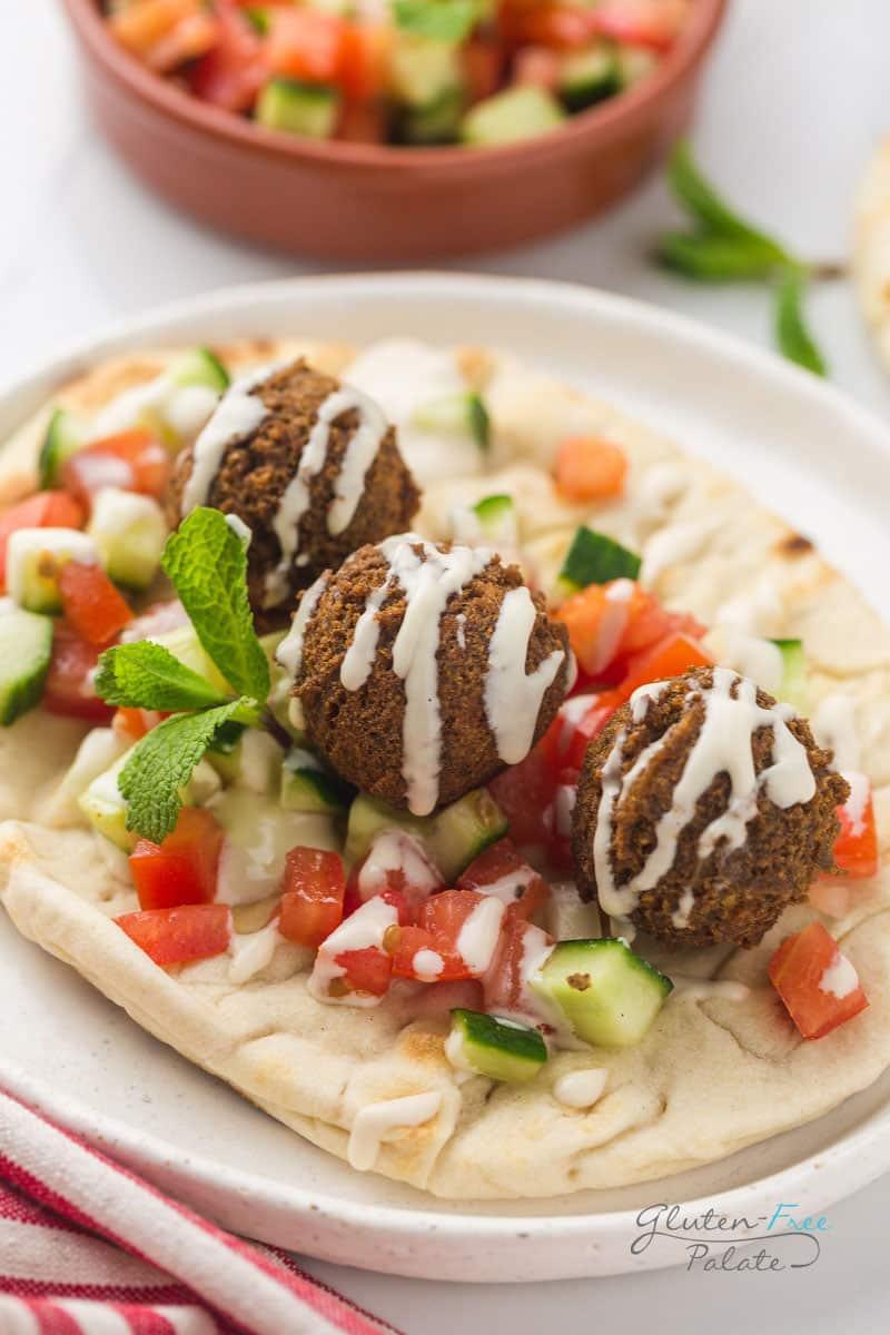 three gluten free falafels on a pita