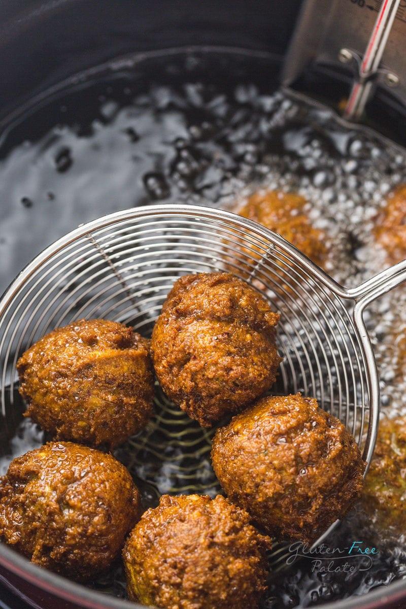 gluten free falafels frying in oil