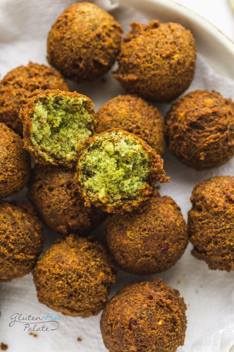 gluten free falafel on a white plate one is open to show texture