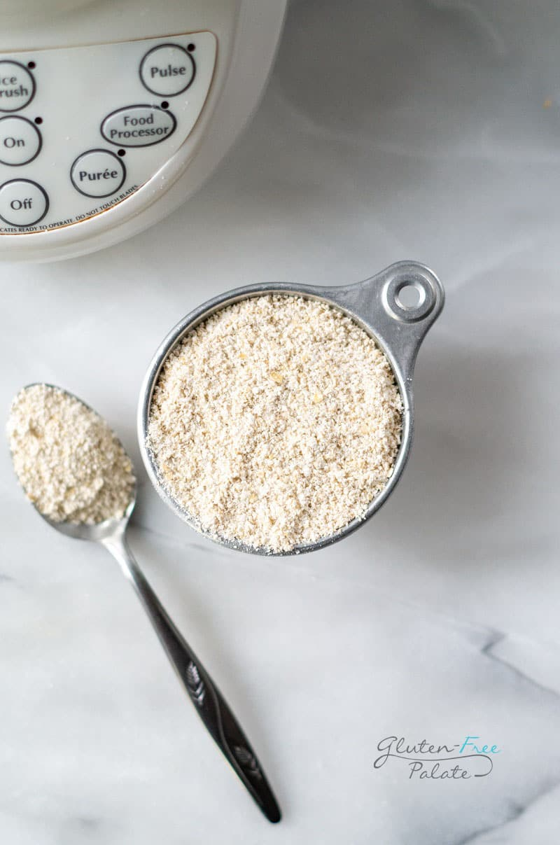 a measuring cup with oat flour