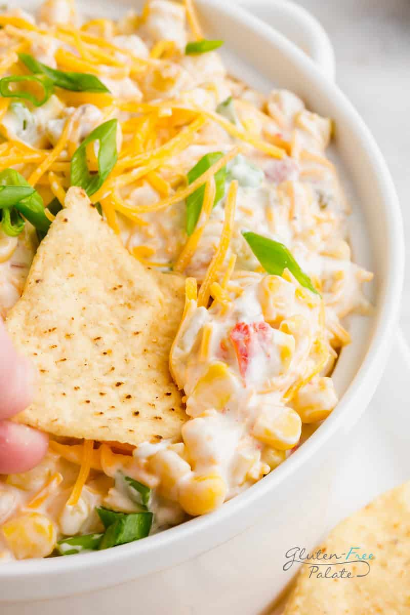 a chip dipping into crack corn dip