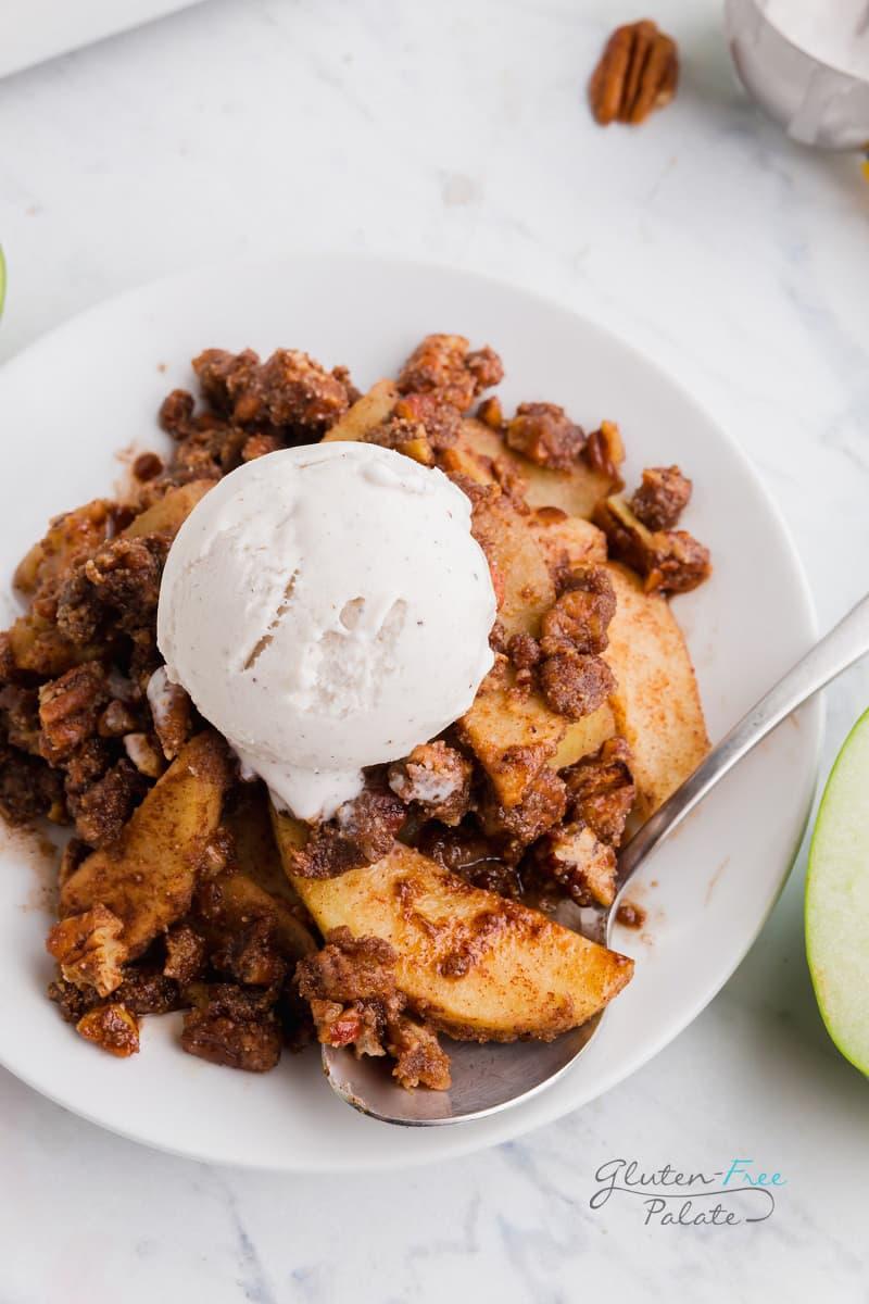 paleo apple crisp with a scoop of vanilla ice cream on top