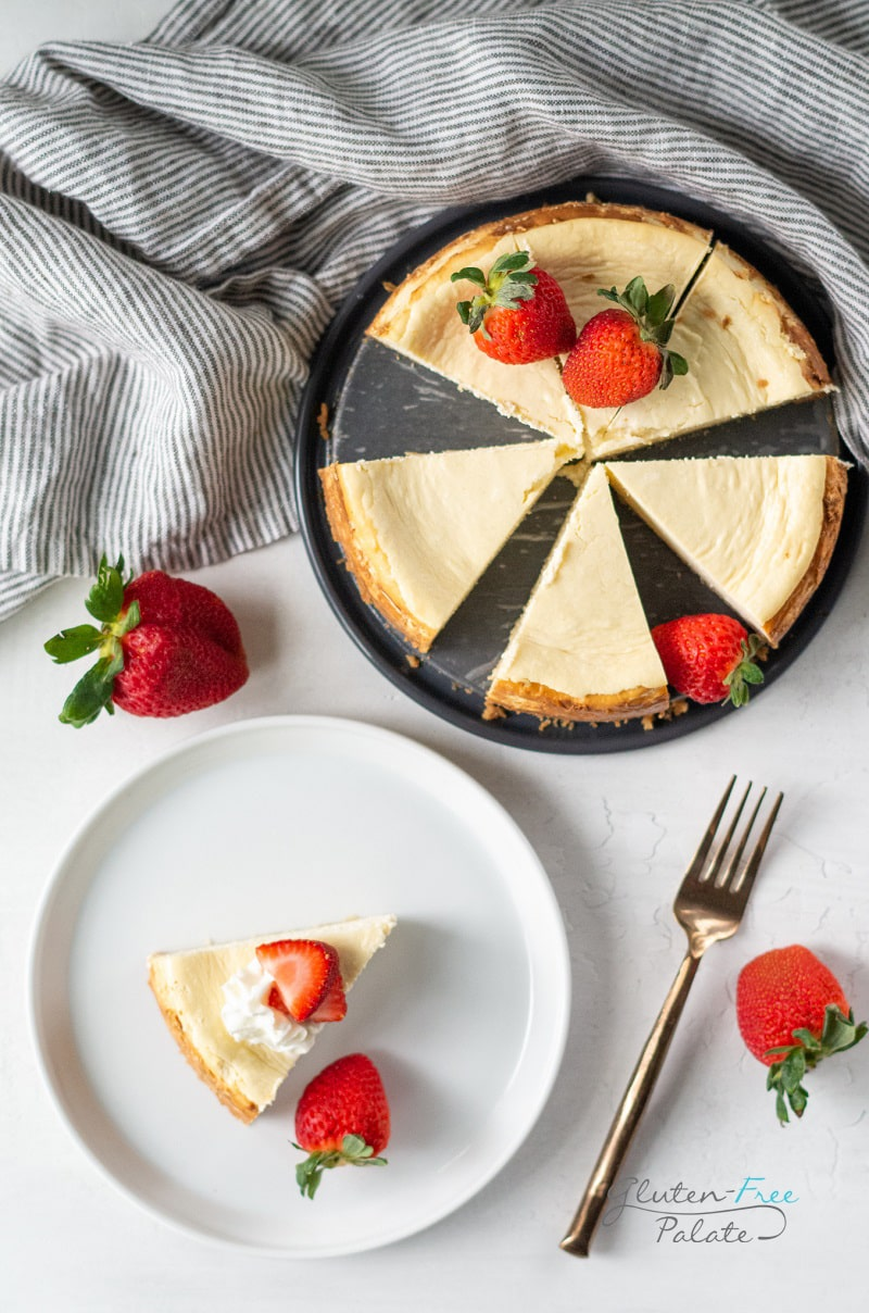gluten free cheesecake on a pan next to a plate with cheesecake