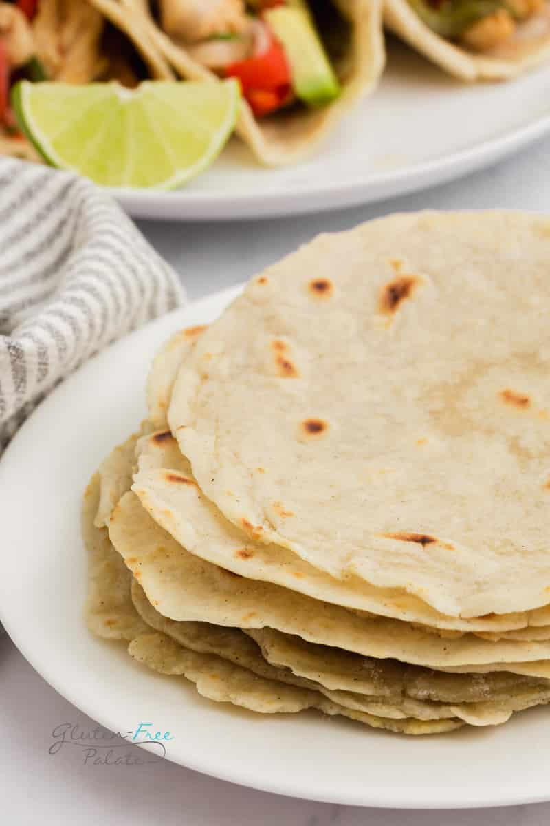 a stack of gluten free tortillas on a white plate