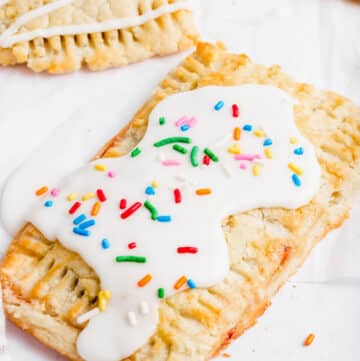 gluten free pop tart topped with a white glaze and sprinkles