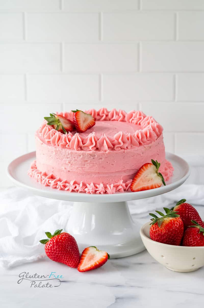 gluten free strawberry cake on a white cake platter