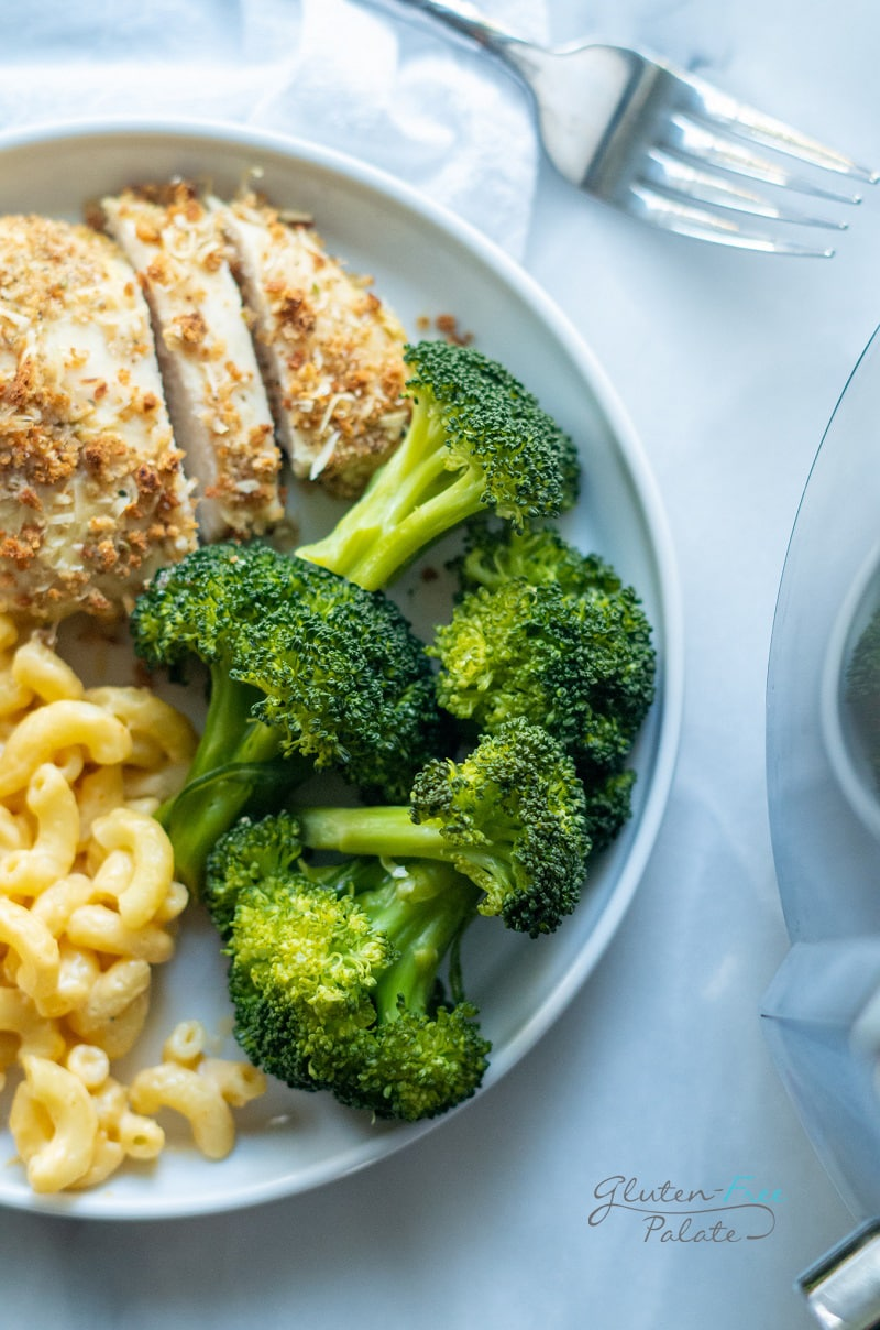 instant pot broccoli on a white plate with chicken and mac
