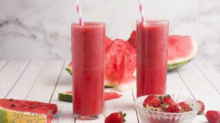 two glasses filled with strawberry watermelon smoothie
