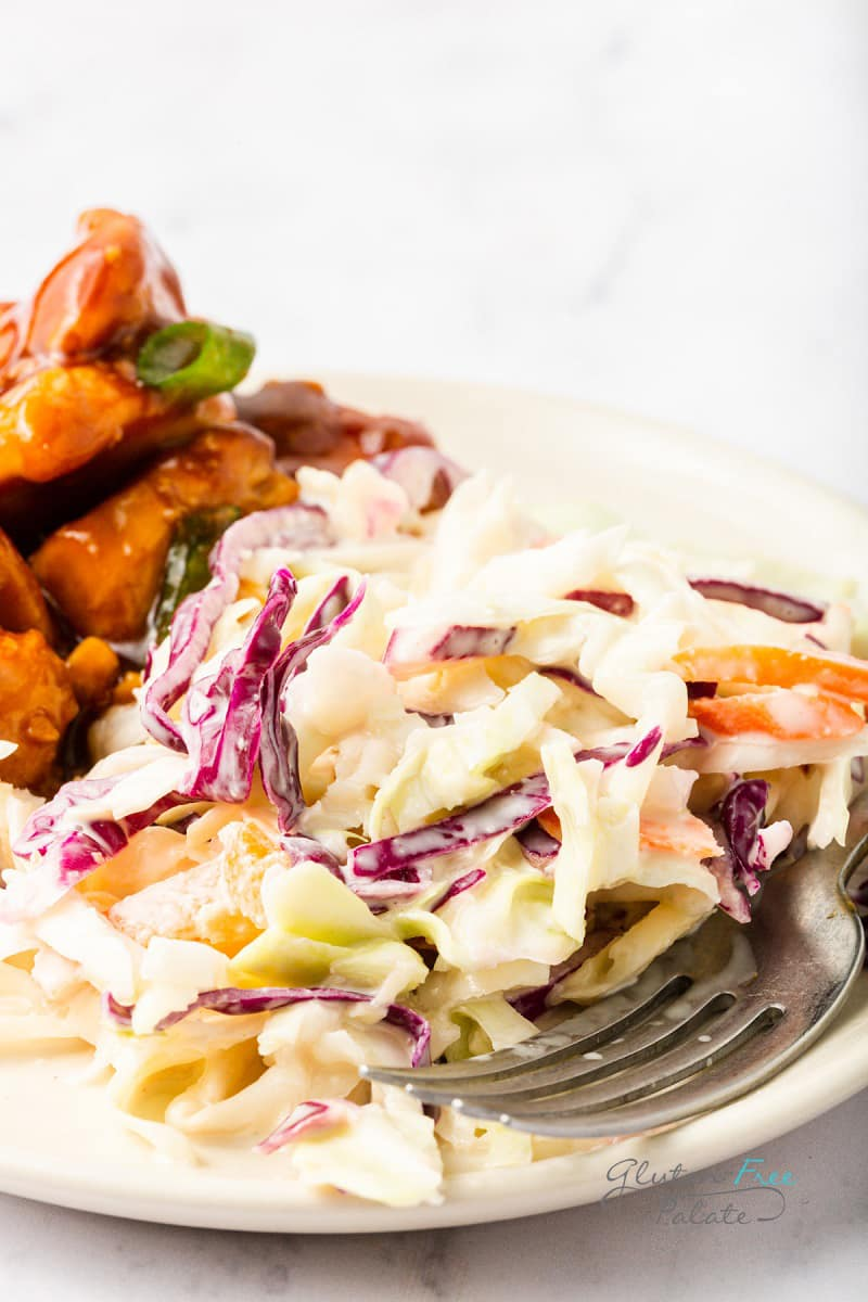 a dinner plate with coleslaw and bbq chicken.