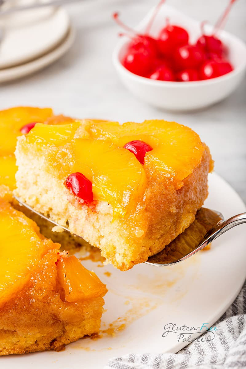 pineapple upside down cake being served with a cake server.