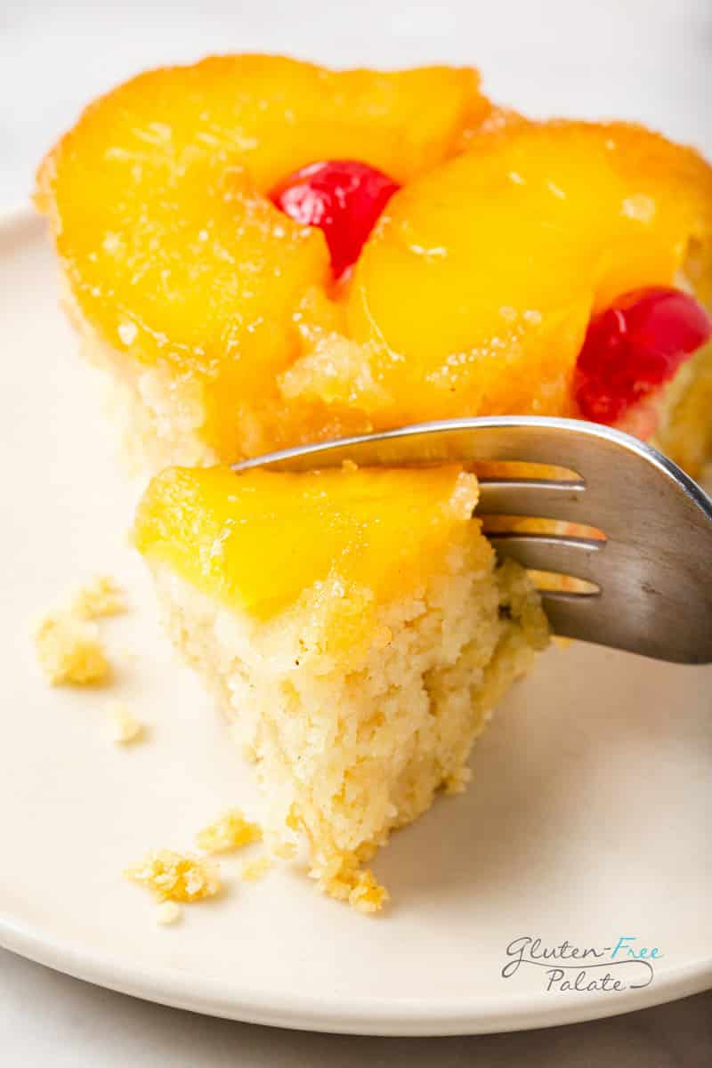 a slice of pineapple cake being eaten with a fork.