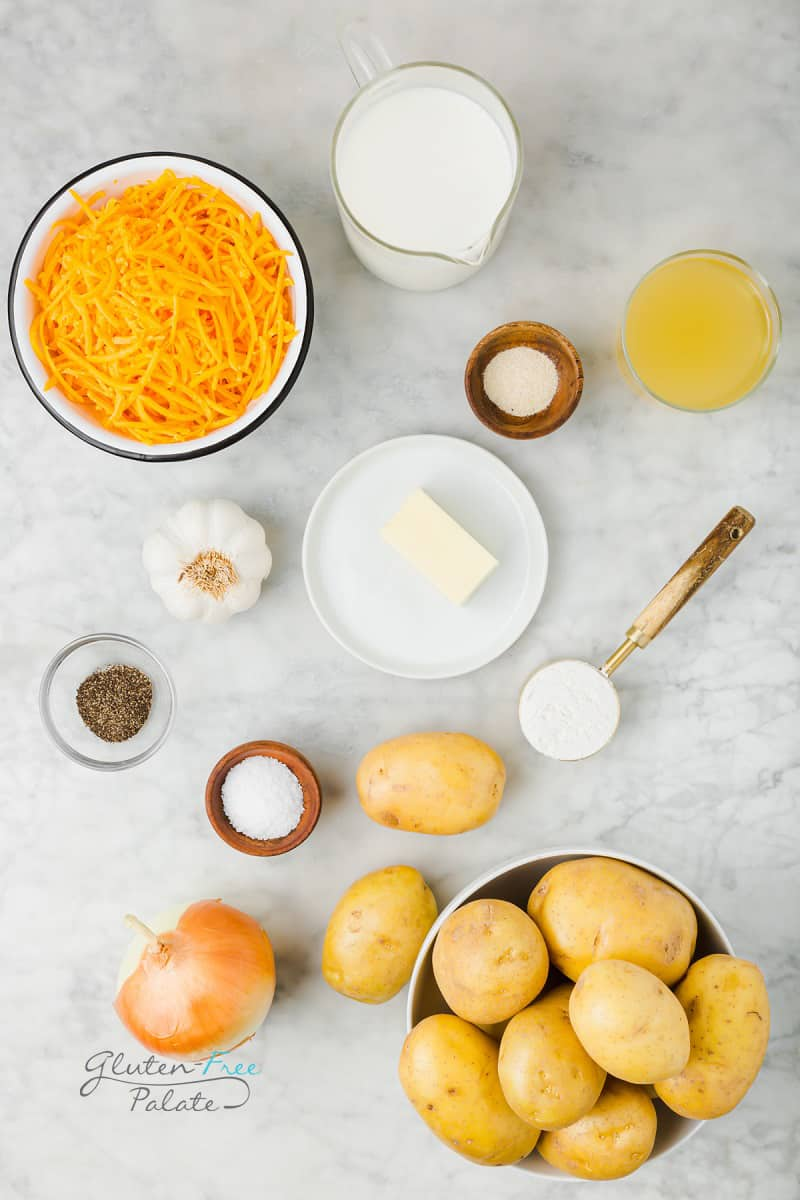 top down shot of the ingredients needed to make gluten free scalloped potatoes, all in separate bowls.
