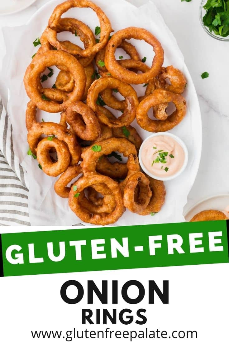 an oval platter of battered onion rings with a side of creamy dip. Text overlay says Gluten Free Onion Rings