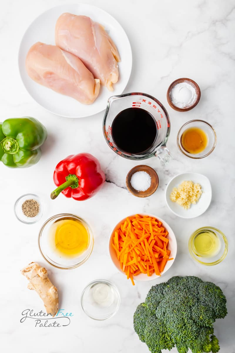 Ingredients for instant pot chicken stir fry laid out on a marble countertop.