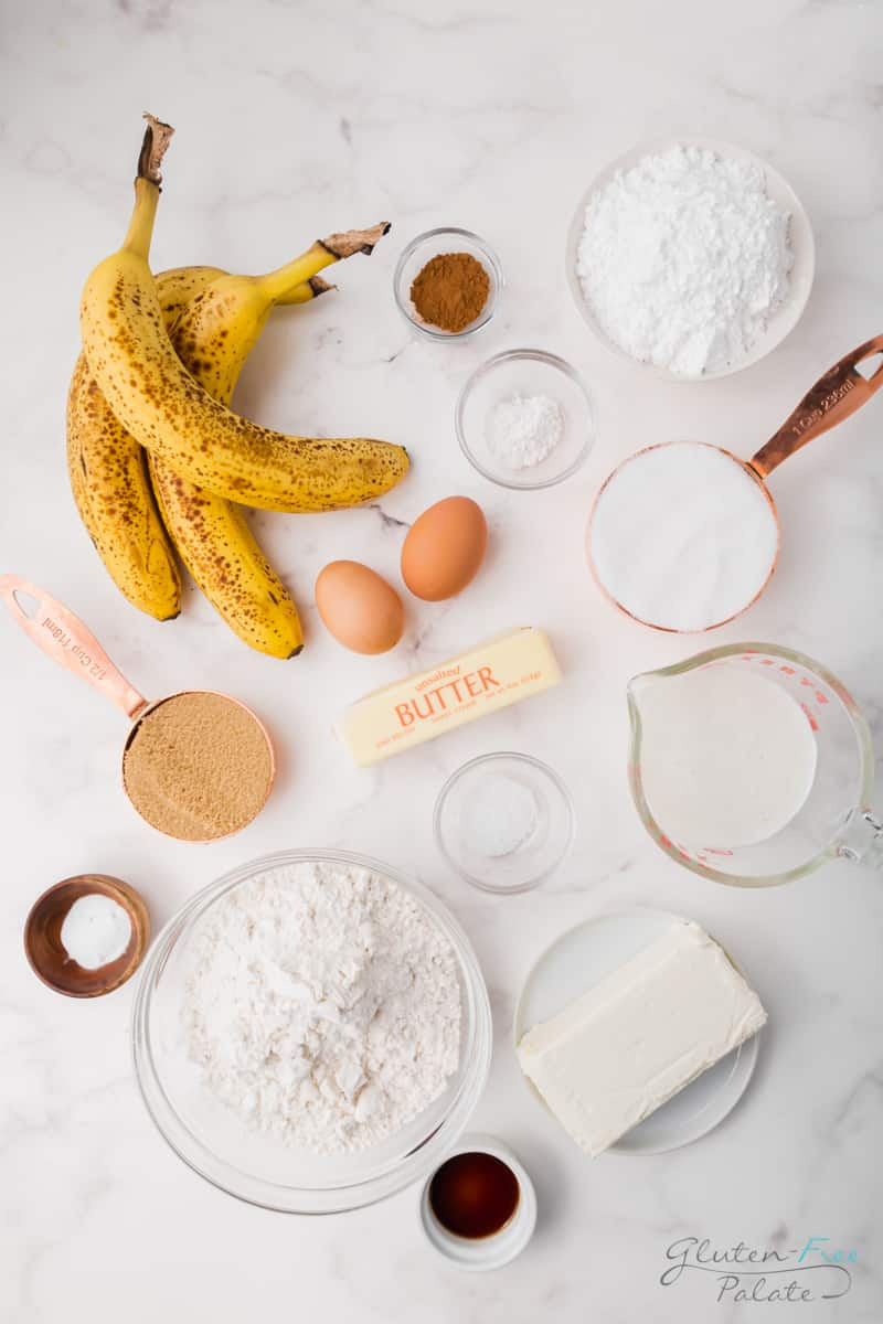 Ingredients needed to make gluten free banana cake, laid out on a marble countertop