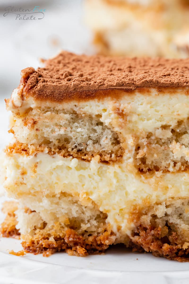 closeup image of a slice of gluten free tiramisu with layers of lady fingers and creamy filling.